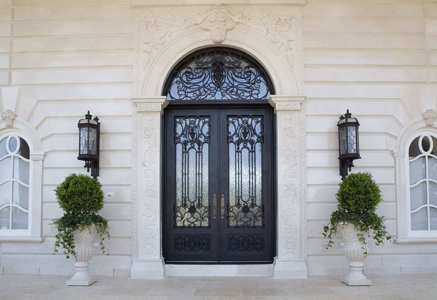 Estate entrance with custom doors