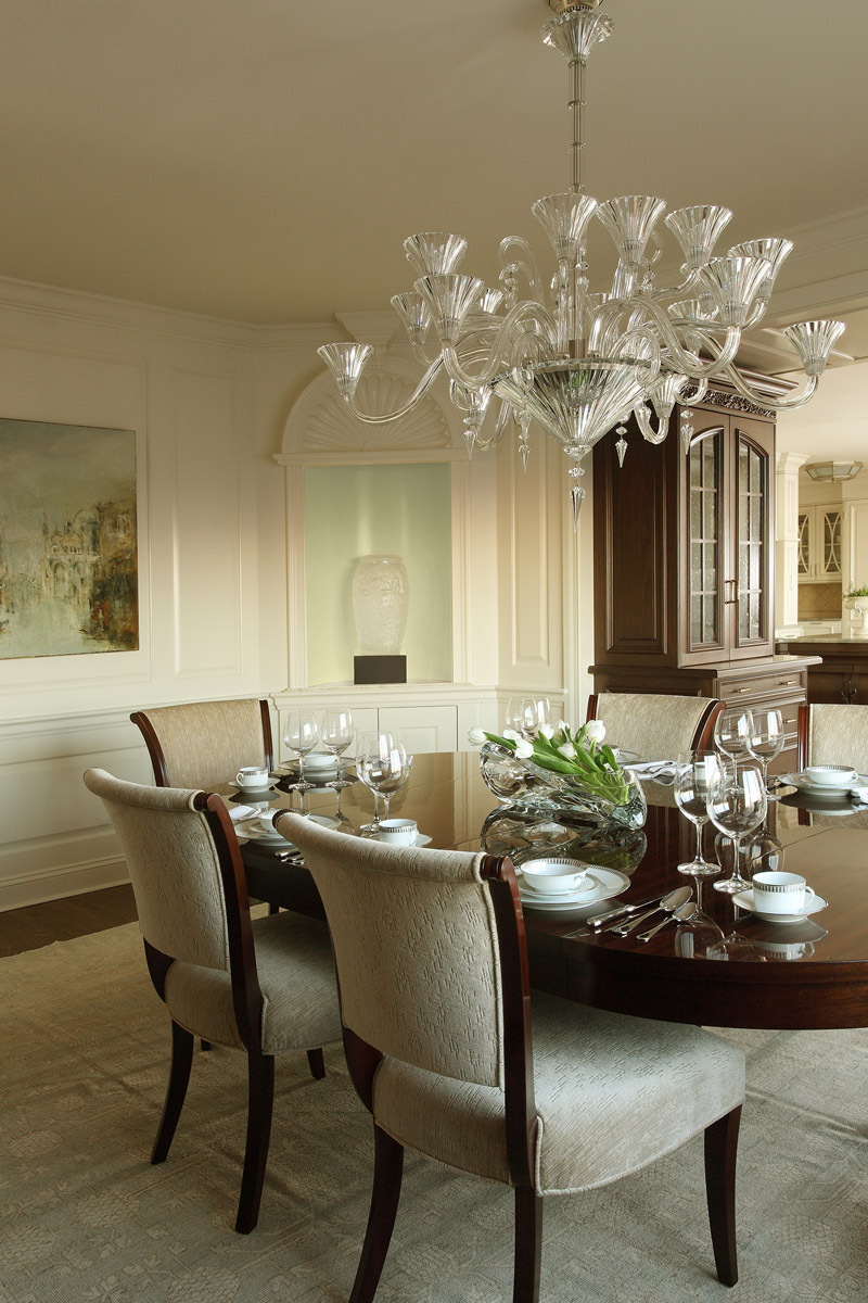 Dining Room with crystal chandelier and neutral color walls in a Four Seasons Penthouse.