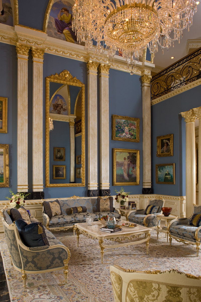 Grand Salon with European Artwork on the walls with classical furniture in blue, beige and Gold