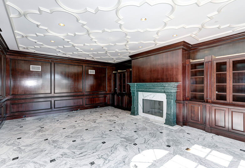 Basement with fireplace and built-in cabinets