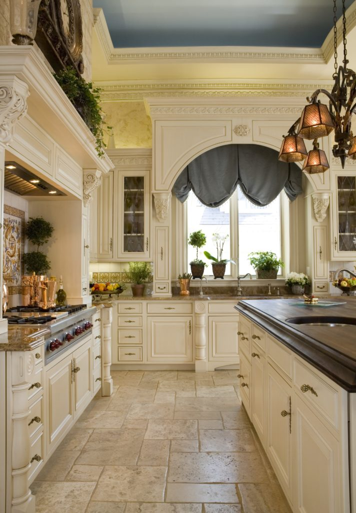 Kitchen with custom cabinetry and kitchen island with Butcher block countertop