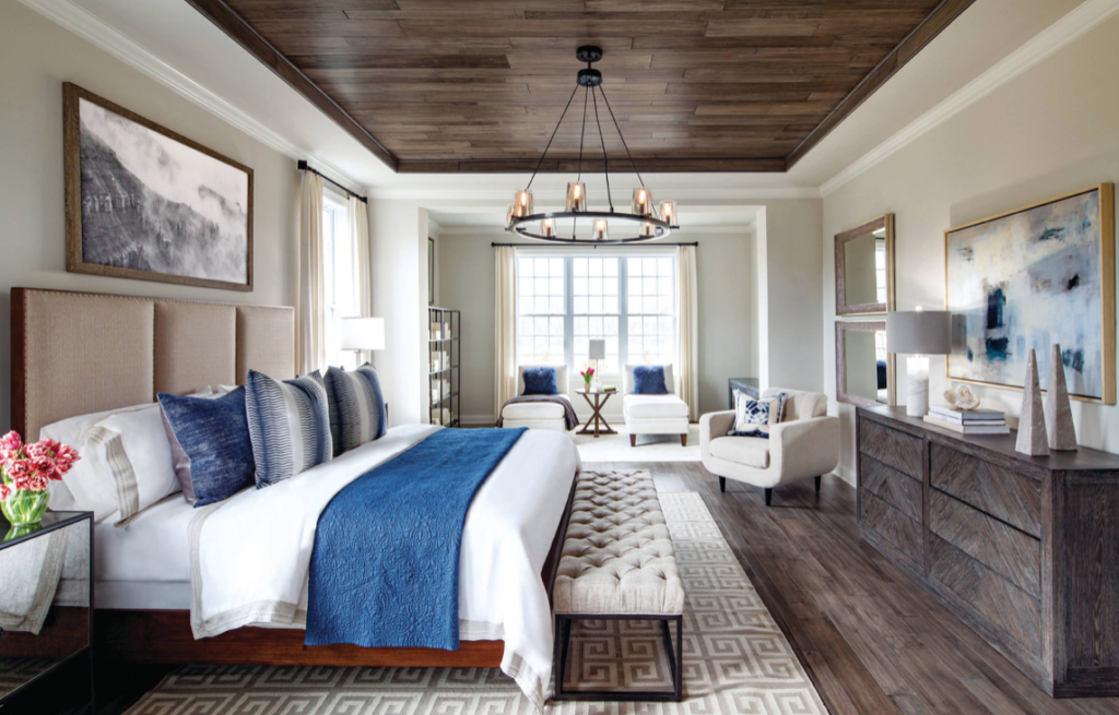 Master Bedroom with Blue and White tones and wood pannel ceiling