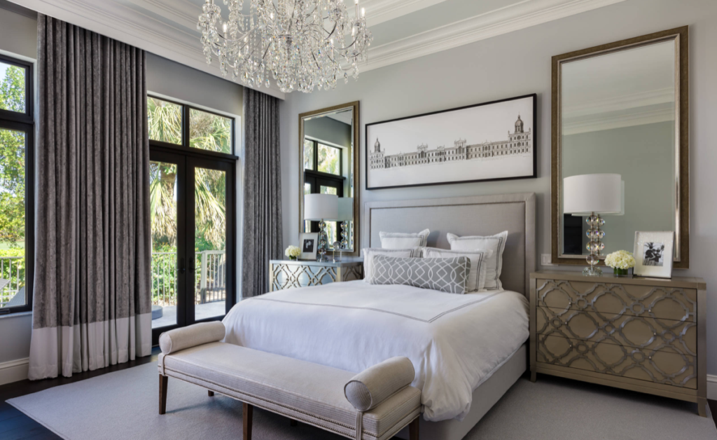 Master Bedroom with neutral colors and a chandelier