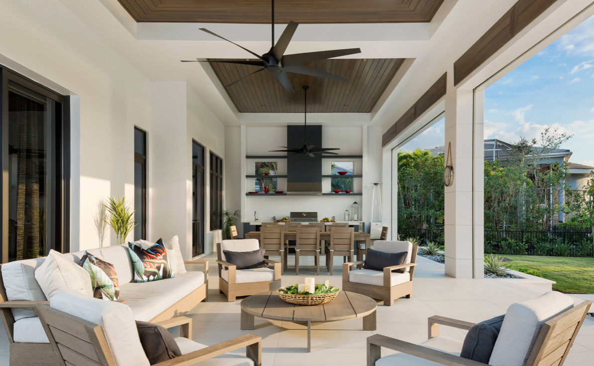 Outdoor living room with entertainment center, dining table and fan