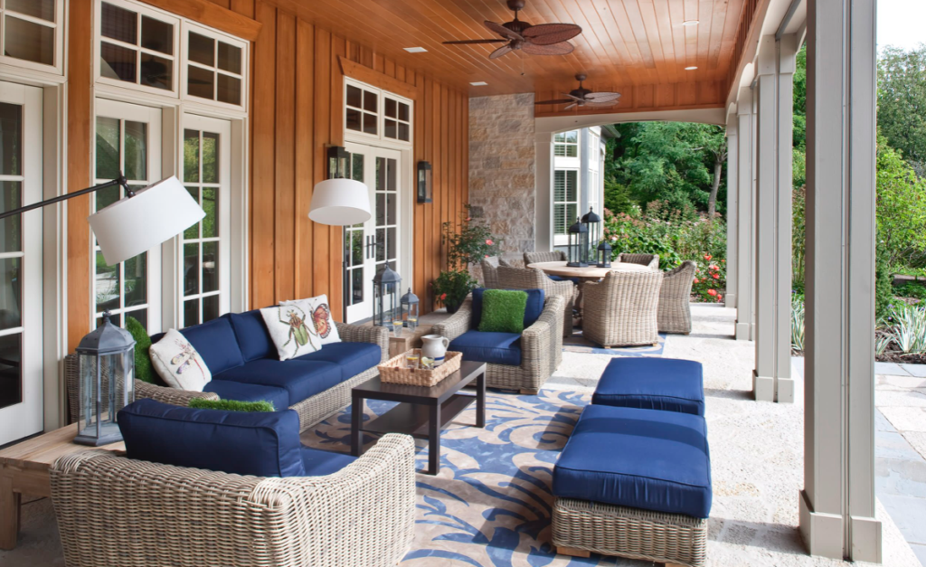 Outdoor living room with blue and tan furniture