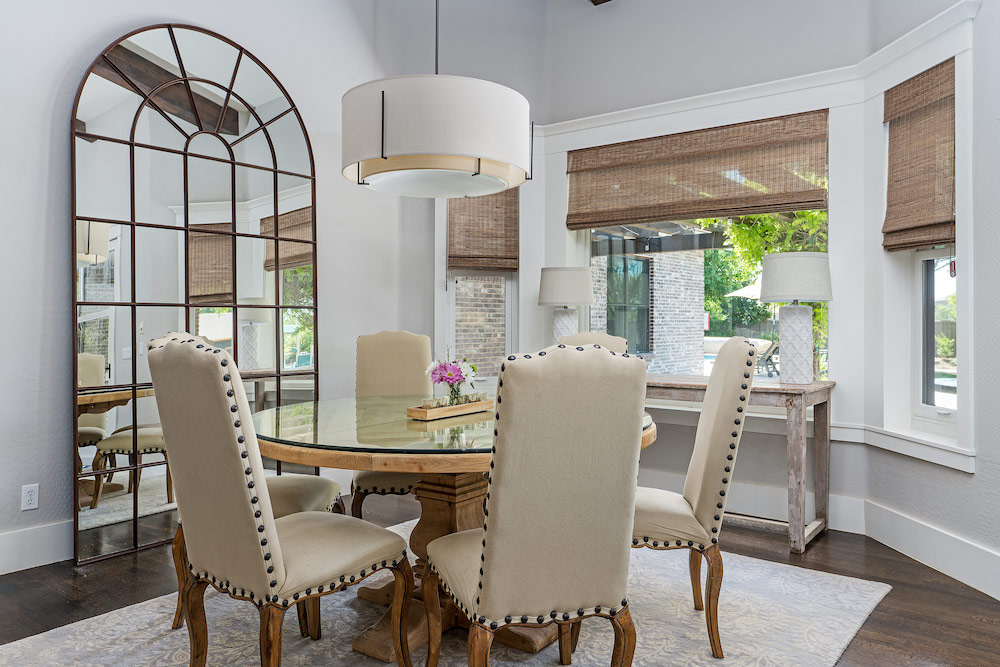 Nautical Design Dining Room with a Large Mirror